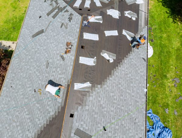 RainTech Roofing - Roofer working on replacement asphalt shingle roof